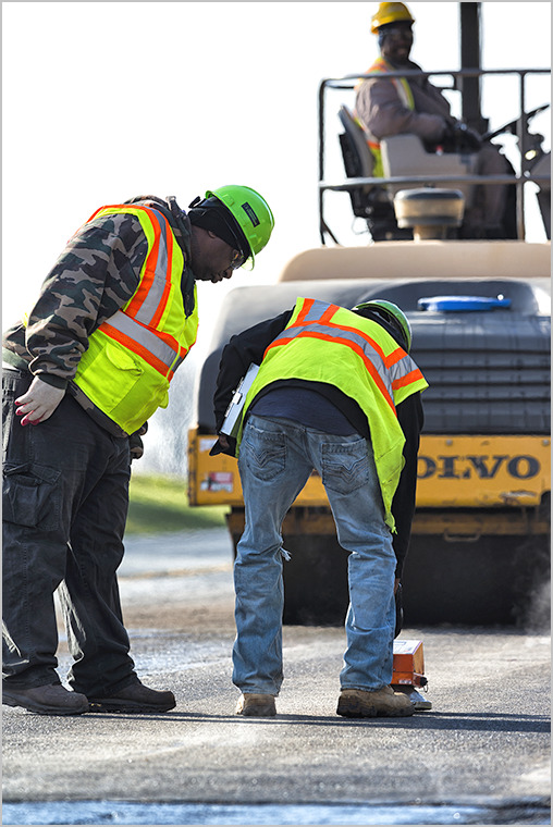 Workers performing maintenance on a road
