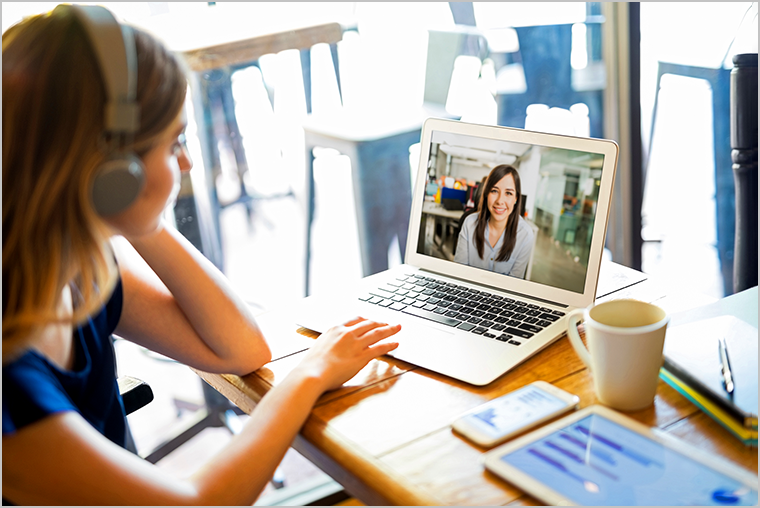 Woman attending a virtual meeting on a laptop